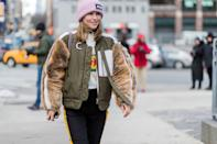 <p>If you're going bold with your outerwear, a beanie in a bright color or one that echoes the same textures on your coat or jacket is a simple way to create a more cohesive style.</p>