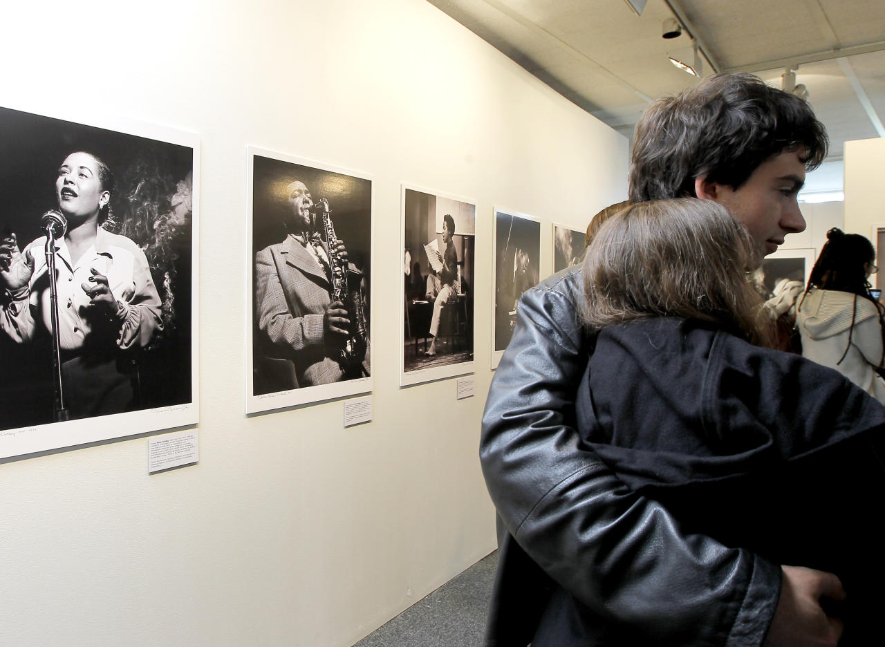 Visitors look around the Jazz exhibition during international Jazz Day at the UNESCO headquarters in Paris, Friday, April 27, 2012. (AP Photo/Jacques Brinon)