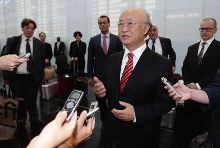 IAEA Director General Amano talks to the media as he arrives at Vienna's airport
