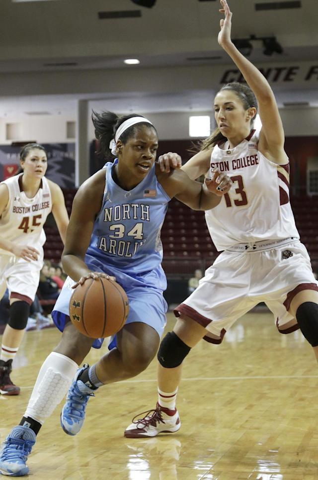 North Carolina forward Xylina McDaniel (34) drives toward the basket past Boston College forward Alexa Coulombe (13) in the first half of an NCAA college basketball game on Sunday, Jan. 19, 2014, in Boston. (AP Photo/Steven Senne)