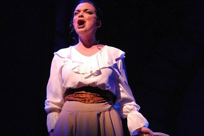 "Ann Marie Olson in Slow Burn Theatre's 2015 production of ""Parade,"" by Jason Robert Brown. The year, the company will stage Brown's ""Songs for a New World"" in an open-air courtyard at The Broward Center."