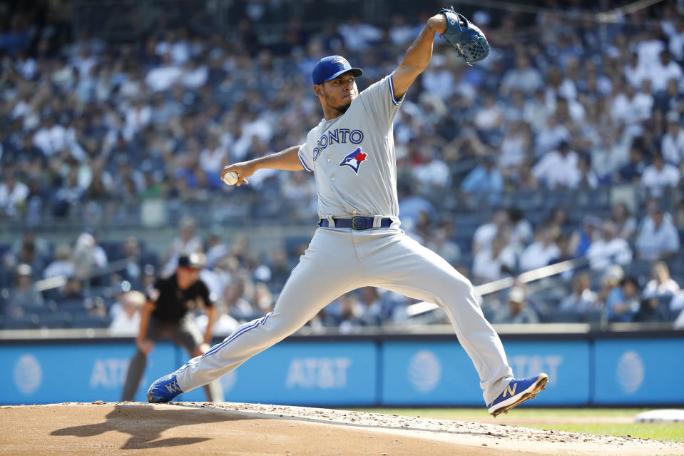 Toronto Blue Jays' Wilmer Font pitches against the New York Yankees during the first inning of a baseball game, Sunday, Sept. 22, 2019, in New York. (AP Photo/Michael Owens)