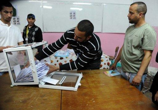 Officials start counting votes in Algiers. The country's former single party tightened its grip on power in an election that bucked the regional trend, according to results that drew accusations of fraud from the defeated Islamists