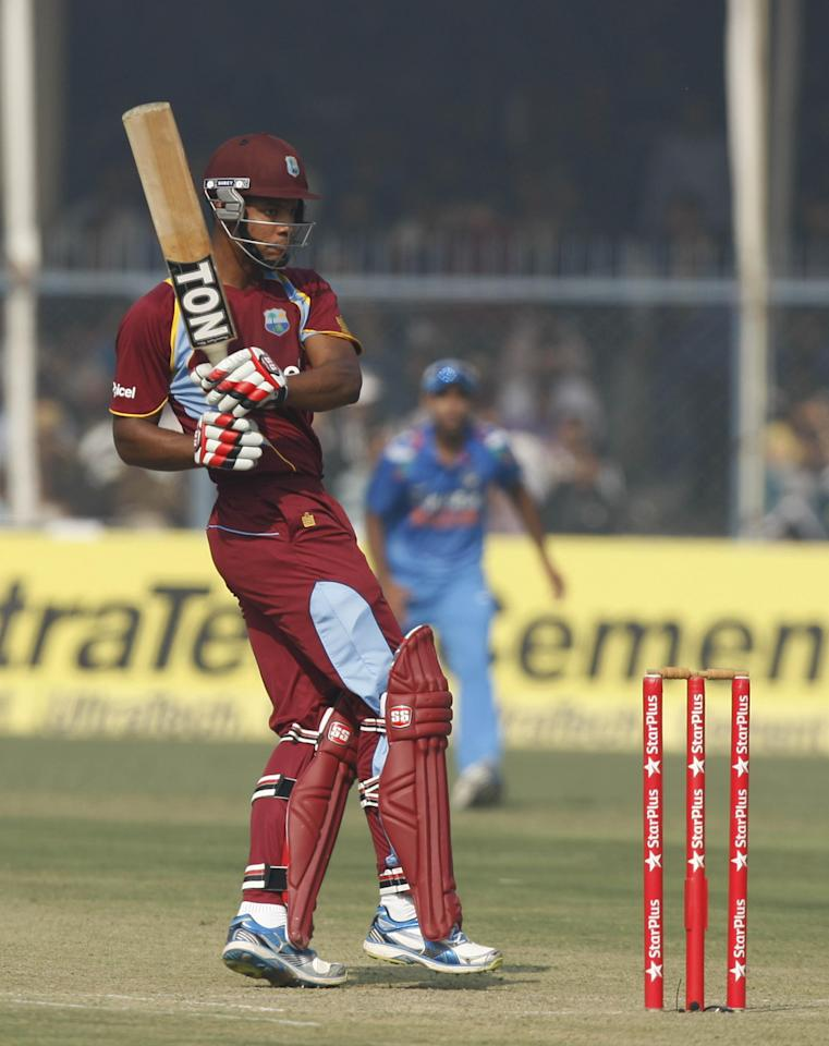 West Indian batsman Kieran Powell in action during the 3rd ODI match between India and West Indies at Green Park Stadium in Kanpur on Nov.27, 2013. (Photo: IANS)