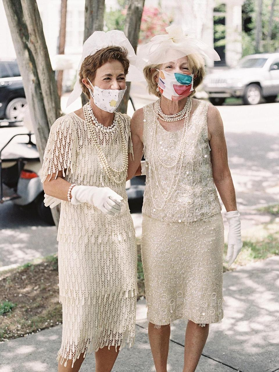 Some of my mom's oldest friends, who are also the mothers of some of <em>my</em> oldest friends, party crashed on their golf cart! They wore gloves, tissue paper veils, pearls, and the dresses they wore to their own wedding rehearsals. It was hilarious!