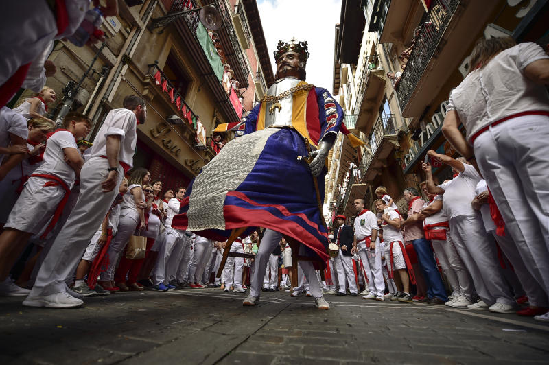 A giant member of San Fermin Comparsa Parade take part in a procession at the San Fermin Festival in Pamplona, northern Spain, July 7, 2019. (Photo: Alvaro Barrientos/AP)