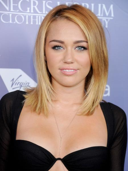 Miley before she shaved her head. (Photo by Gregg DeGuire/WireImage)