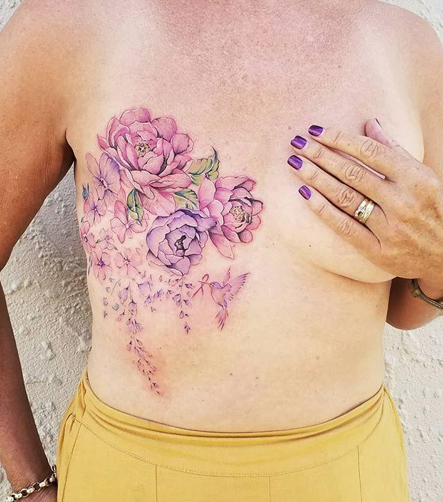 "<p>Getting a bouquet of watercolor flowers tattooed post-mastectomy shows how you'll bloom in the next chapter of your life.</p><p><a href=""https://www.instagram.com/p/B8c6KjmApDy/?igshid=justryg0ude0"" rel=""nofollow noopener"" target=""_blank"" data-ylk=""slk:See the original post on Instagram"" class=""link rapid-noclick-resp"">See the original post on Instagram</a></p>"