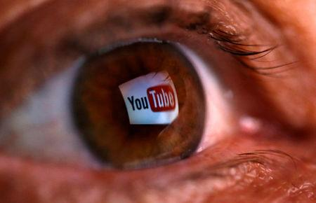 FILE PHOTO: A picture illustration shows a YouTube logo reflected in a person's eye