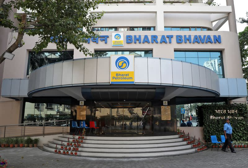 A private security guard stands in front of the regional head office of oil refiner Bharat Petroleum Corp in Kolkata