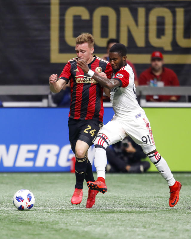 Atlanta United defender Julian Gressel (24) battles against D.C. United midfielder Oniel Fisher (91) in the first half of an MLS soccer game on Sunday, March 11, 2018, in Atlanta. (AP Photo/Todd Kirkland)