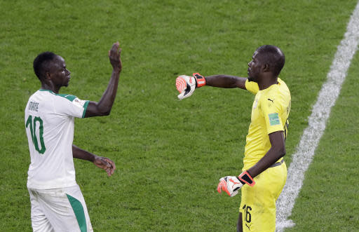 Senegal's Sadio Mane, left, gestures to teammate Khadim Ndiaye at the end of their group H match between Japan and Senegal at the 2018 soccer World Cup at the Yekaterinburg Arena in Yekaterinburg , Russia, Sunday, June 24, 2018. (AP Photo/Mark Baker )