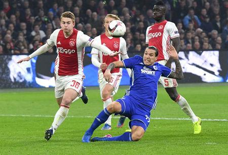 Football Soccer - Ajax Amsterdam's v Kobenhavn- UEFA Europa League Round of 16 Second Leg - Amsterdam Netherlands - 16/03/17 - Ajax Amsterdam's Matthijs de Ligtand and Kobenhavn's Federico Santander in action. REUTERS/United Photos/Toussaint Kluiters