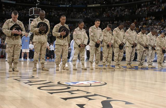 Members of the U.S. Military spend a moment of silence remembering fallen Army Ranger and Former NFL player Pat Tillman before the Denver Nuggets against the Minnesota Timberwolves in Game four of the Western Conference Quarterfinals during the 2004 NBA Playoffs April 27, 2004 at Pepsi Center in Denver, Colorado. (Photo by Garrett W. Ellwood/NBAE via Getty Images)
