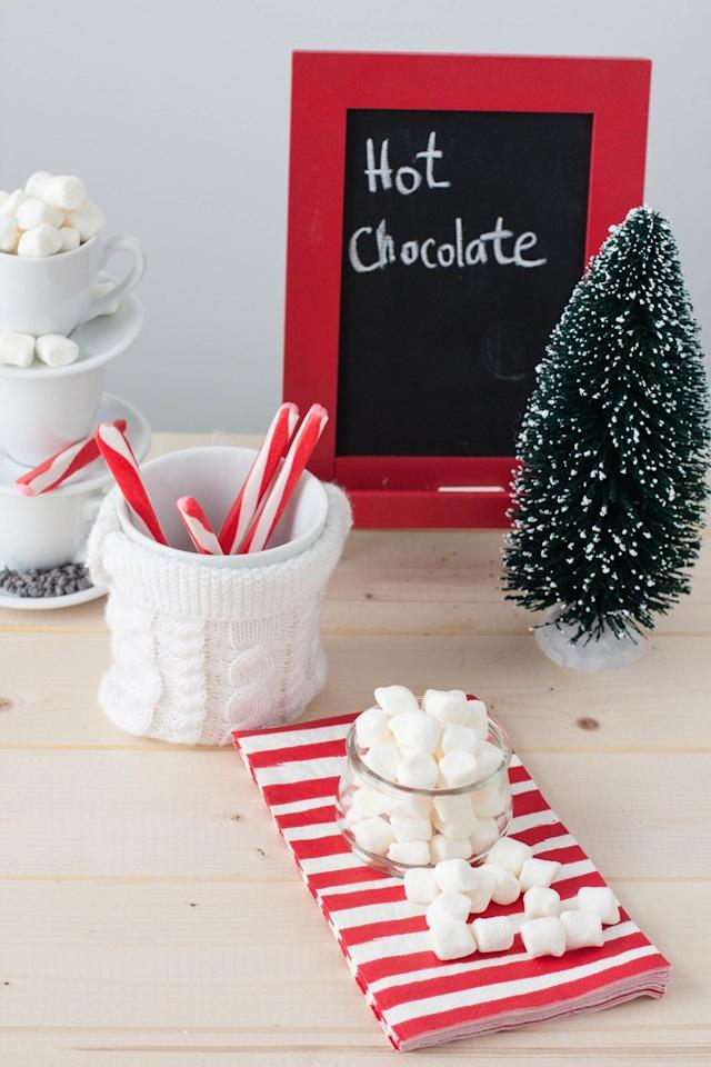 Hot cocoa is one of the best parts of the holidays, so why not upgrade your favorite beverage on Christmas Eve with a whole hot chocolate bar? Put out both dark and milk chocolate choices along with a wide range of toppings—not just whipped cream and marshmallows, but also chocolate shavings, chopped pecans, and crushed-up candy canes. Guests will have a blast building the messiest, craziest, and most delicious dessert drink they can!