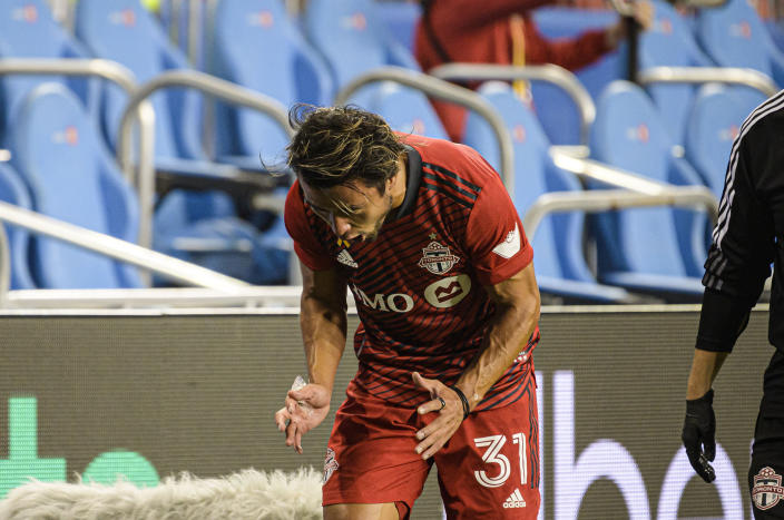 Toronto FC forward Tsubasa Endoh reacts after leaving the game due to injury, during the first half of the team's MLS soccer match against Inter Miami on Tuesday, Sept. 14, 2021, in Toronto. (Christopher Katsarov/The Canadian Press via AP)