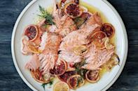"""This elegant salmon dish bridges the gap between winter and spring effortlessly—just slide it into a low oven for 40 minutes and it's ready to enjoy. This is one of those recipes that we return to again and again; it just works so perfectly every time. <a href=""""https://www.epicurious.com/recipes/food/views/slow-roasted-salmon-with-fennel-citrus-and-chiles-51210470?mbid=synd_yahoo_rss"""" rel=""""nofollow noopener"""" target=""""_blank"""" data-ylk=""""slk:See recipe."""" class=""""link rapid-noclick-resp"""">See recipe.</a>"""