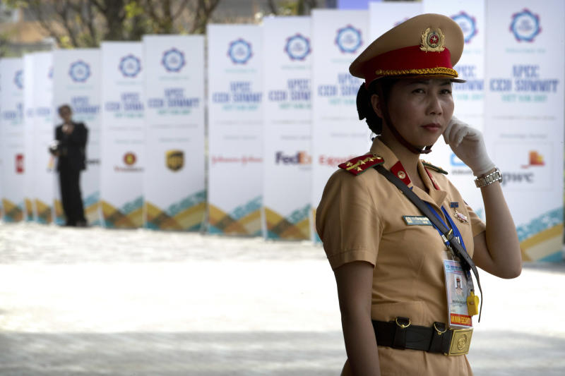 FIEL - In this Nov. 9, 2017, file photo, a Vietnamese security official stands guard outside the venue for the Asia-Pacific Economic Cooperation (APEC) CEO Summit in Danang, Vietnam. U.S. President Donald Trump said Tuesday, Feb. 5, 2019 that he will hold a two-day summit with North Korea leader Kim Jong Un Feb. 27-28 in Vietnam to continue his efforts to persuade Kim to give up his nuclear weapons. As a single-party communist state, Vietnam boasts tight political control and an efficient security apparatus, and successfully hosted the APEC meetings in 2017, and the regional edition of the high-powered World Economic Forum in 2018, both in the central coastal city of Danang. (AP Photo/Mark Schiefelbein, File)