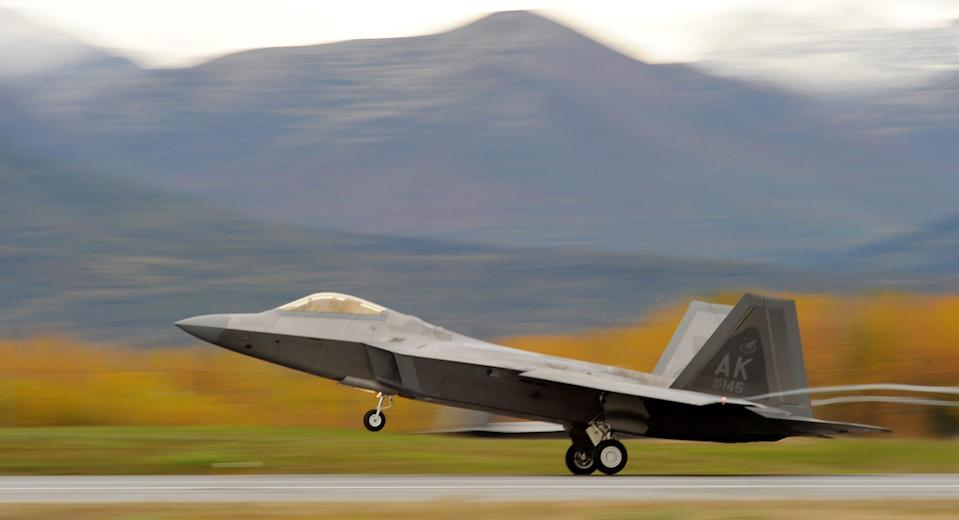 An Air Force F-22 Raptor stealth fighter takes off from Joint Base Elmendorf-Richardson Sept. 21, 2011 in Anchorage, Alaska.