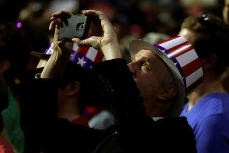 A supporter takes a photo of Republican presidential nominee Donald Trump during a campaign rally in Everett, Washington, U.S., August 30, 2016. REUTERS/Carlo Allegri