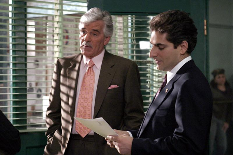 """FILE - In this undated photo from NBC Universal, Dennis Farina, who plays New York Police Detective Joe Fontana, acts in a scene with Michael Imperioli in the role of Detective Nick Falco, in an episode from NBC's police drama,""""Law & Order."""" Farina died suddenly on Monday, July 22, 2013, in Scottsdale, AZriz., after suffering a blood clot in his lung. He was 69. (AP Photo/ NBC Universal,Jessica Burstein)"""