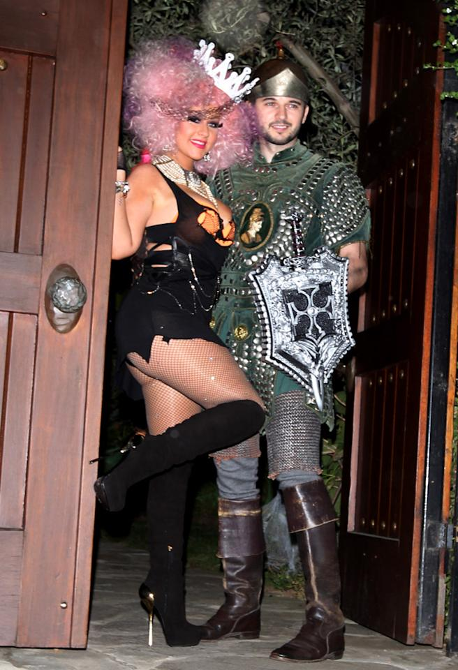 October 27, 2012: Christina Aguilera and her boyfriend Matthew Rutler show some PDA while posing for photos sporting Halloween costumes outside Christina's home in Los Angeles, California.