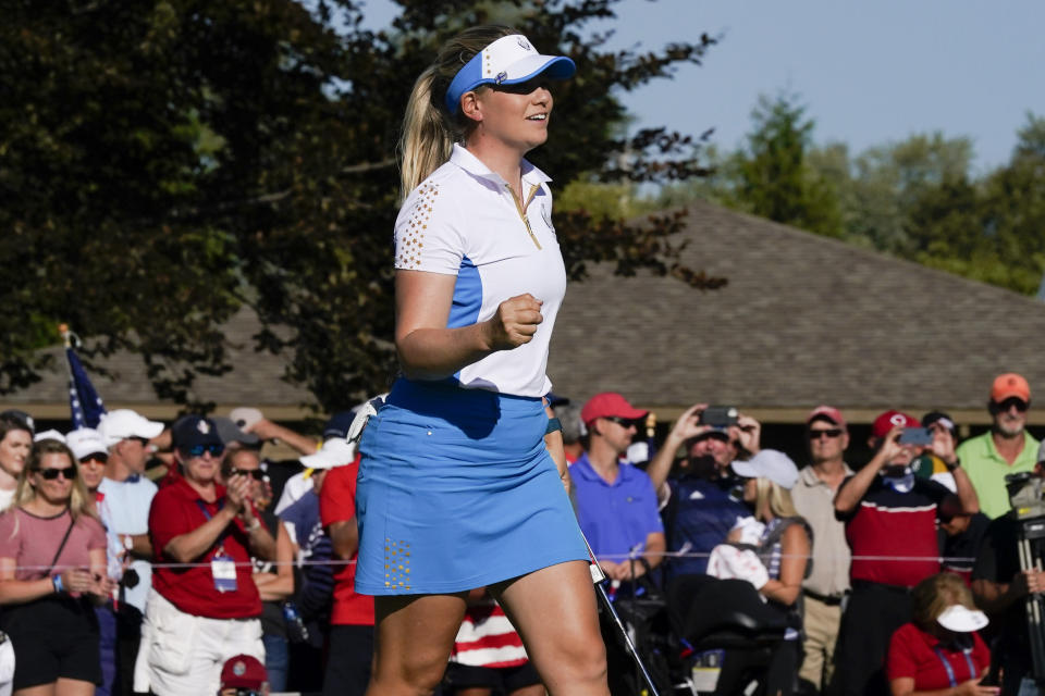 Europe's Matilda Castren celebrates after her win on the 18th hole agains United States' Lizette Salas during the singles matches at the Solheim Cup golf tournament, Monday, Sept. 6, 2021, in Toledo, Ohio. (AP Photo/Carlos Osorio)
