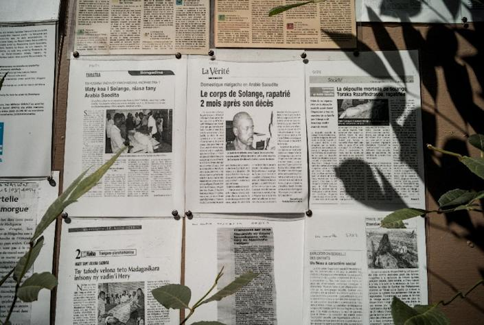A picture taken on July 22, 2014 shows copies of articles from Madagascar's newspapers on workers's abuses in the Gulf region at the SPDTS office in Antananarivo (AFP Photo/Rijasolo)