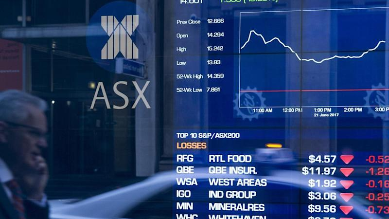 The Australian share market was higher at noon on Friday.