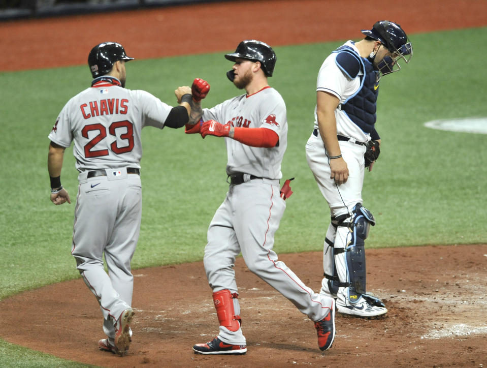 Tampa Bay Rays catcher Mike Zunino, right, looks down as Boston Red Sox's Michael Chavis (23) and Alex Verdugo, center, celebrate Verdugo's two-run home run off Rays starter Ryan Yarbrough during the fourth inning of a baseball game Wednesday, Aug. 5, 2020, in St. Petersburg, Fla. (AP Photo/Steve Nesius)