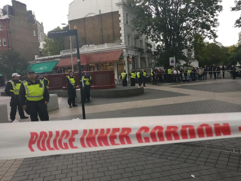 Police stand guard in Exhibition Road, South Kensington, after a car crash left pedestrians injured on 7 October (Shehab Khan/The Independent)