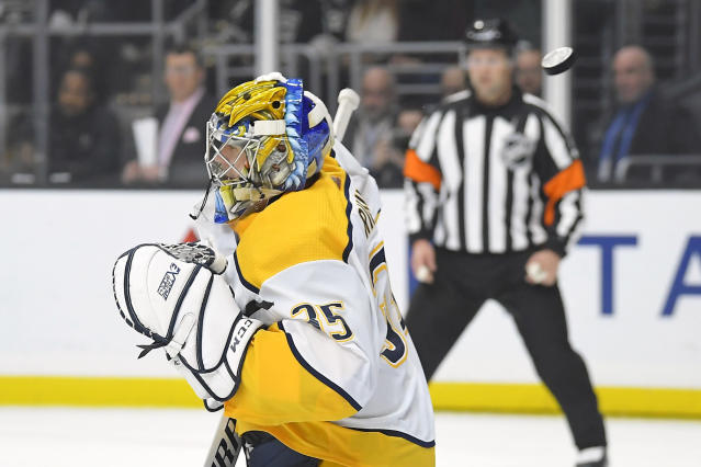 Nashville Predators goaltender Pekka Rinne deflects a shot during the second period of the team's NHL hockey game against the Los Angeles Kings on Saturday, Jan. 4, 2020, in Los Angeles. (AP Photo/Mark J. Terrill)
