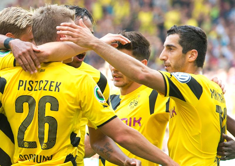 Borussia Dortmund's Henrikh Mkhitaryan (R) celebrates with his teammates after scoring during a German Cup match against Stuttgarter Kickers on August 16, 2014 in Stuttgart