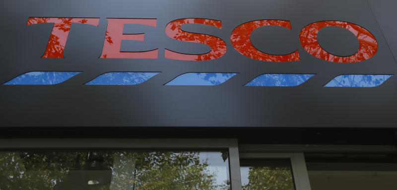 FILE - In this Monday, Sept. 22, 2014 file photo, the sign on a Tesco shop is photographed, in London. The British-based grocery chain Tesco has halted production at a factory in China after a British newspaper said it used forced labor to produce charity Christmas cards. Tesco said Sunday, Dec. 22, 2019 it had stopped production and launched an immediate investigation after the Sunday Times newspaper raised questions about the factory's labor practices. (AP Photo/Kirsty Wigglesworth, file)