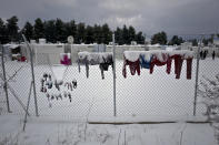 <p>Laundry of Syrian refugees is covered with snow while hung on a fence at the refugee camp of Ritsona about 86 kilometers (53 miles) north of Athens, Jan. 10, 2017. (Photo: Muhammed Muheisen/AP) </p>