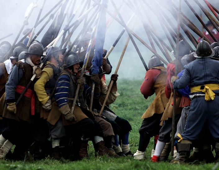 Combatants representing Royalists (L) and Roundheads, or  parliamentarians, re-enact the English Civil War's final Battle of  Worcester on the 350th anniversary of the event September 2, 2001. The  battle, on September 3, 1651, marked the defeat of Royalist forces  under Charles II by the pro-parliamentary New Model Army headed by  Oliver Cromwell. Charles II thereafter fled to France and Cromwell  gained control of England. REUTERS/Chris Helgren    CLH/AA
