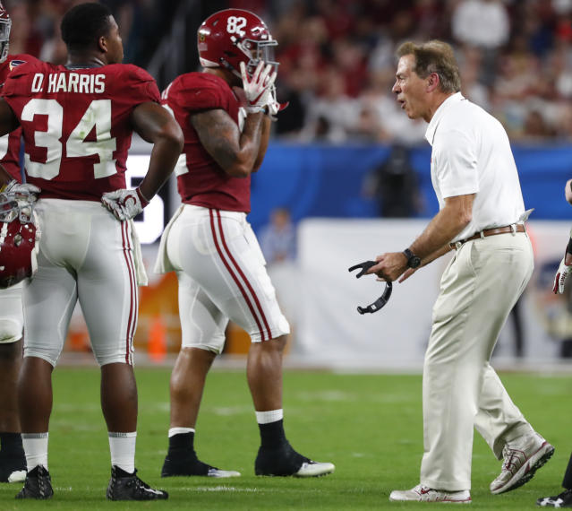 Alabama head coach Nick Saban screams at tight end Irv Smith Jr. (82) and running back Damien Harris (34) during the first half of the Orange Bowl. (AP)