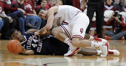 Florida Atlantic's Kelvin Penn and Indiana's Will Sheehey scramble for a loose ball during the first half of an NCAA college basketball game in Bloomington, Ind., Friday, Dec. 21, 2012. (AP Photo Alan Petersime)