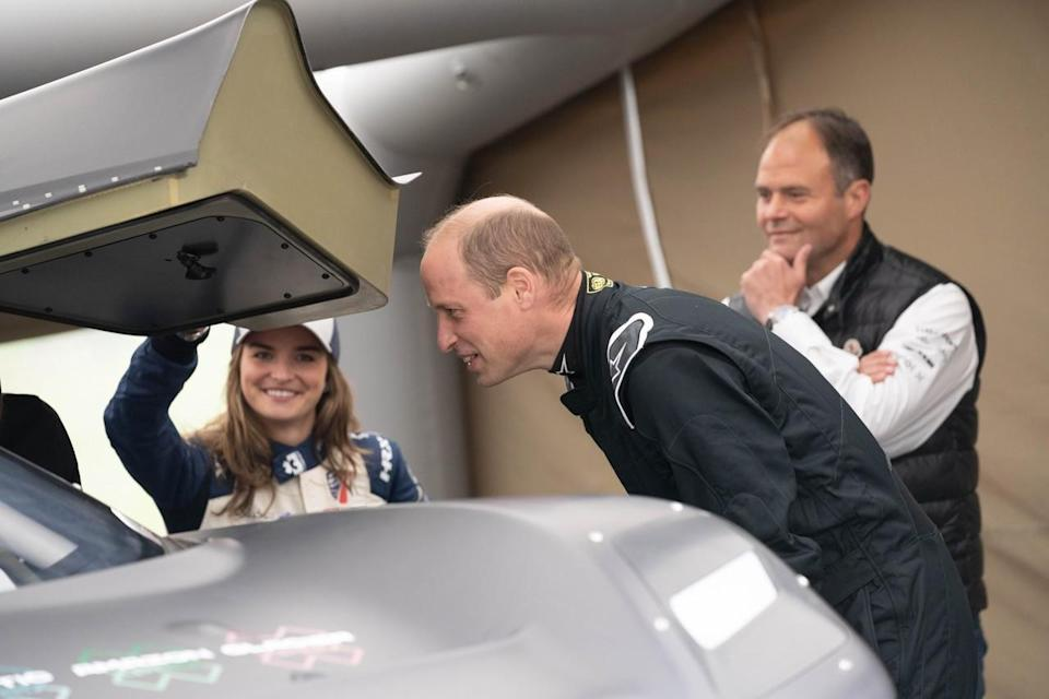 <em>Catie Munnings shows off the Odyssey 21 to Prince William during a test last month in Scotland (Extreme E).</em>