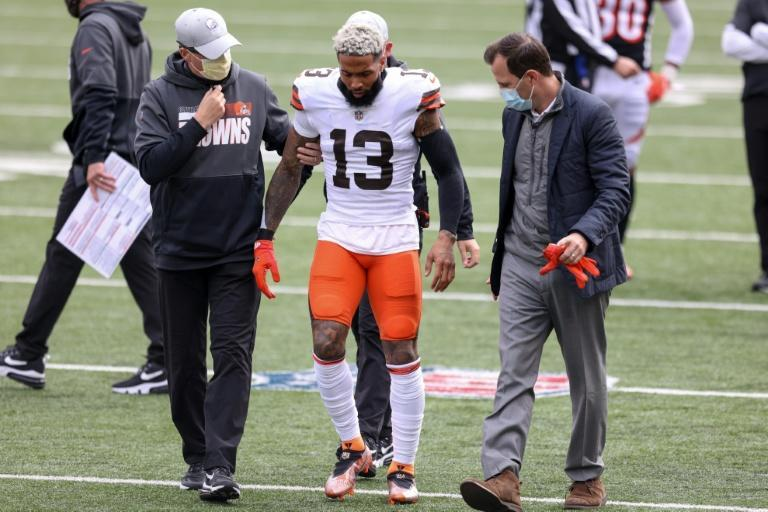 Cleveland Browns star Odell Beckham Jr. leaves the field after suffering a season-ending knee injury against Cincinnati on Sunday
