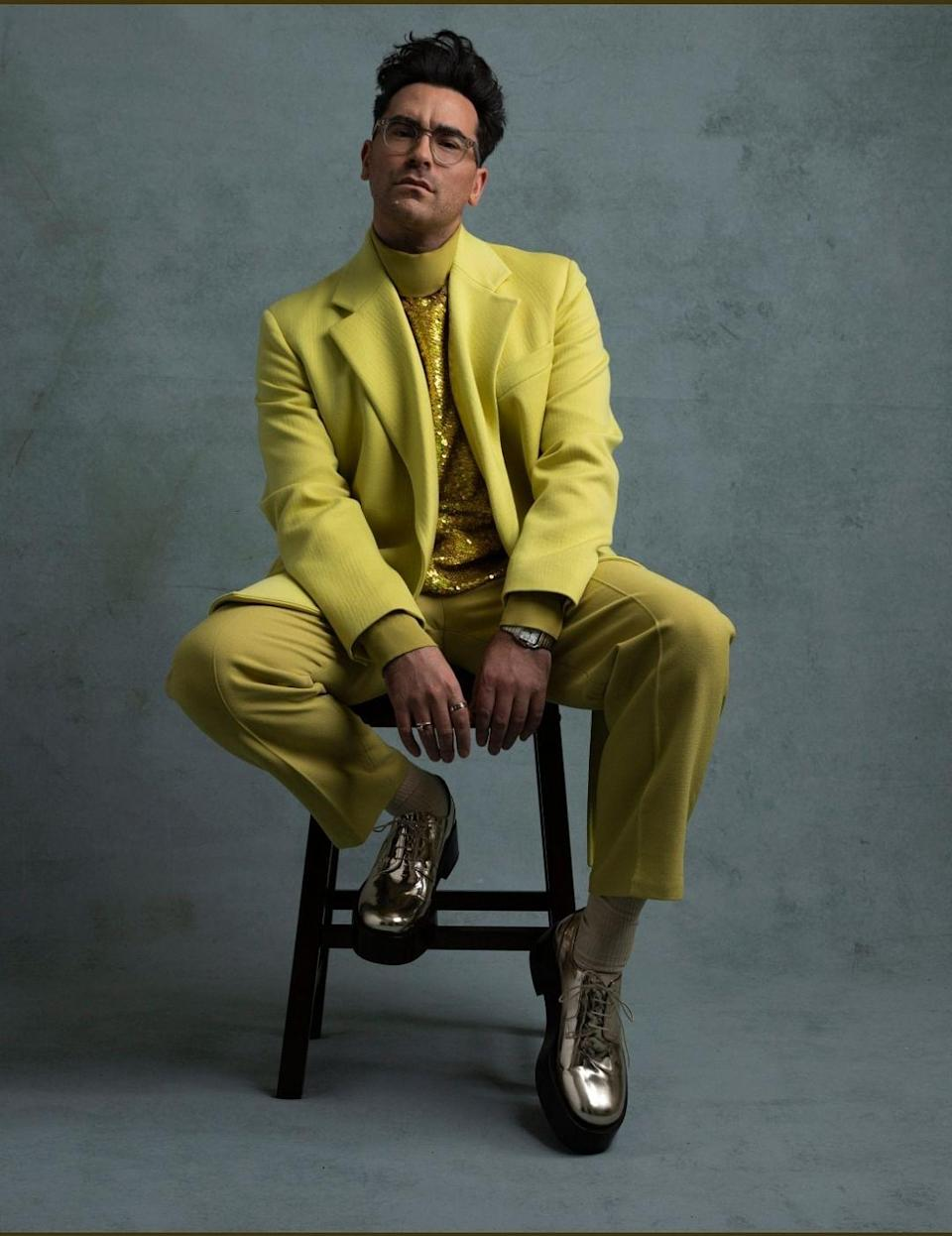 <p>Daniel Levy rocks the chic chartreuse Valentino suit, paired with a sequinned top and metallic platform shoes.</p>