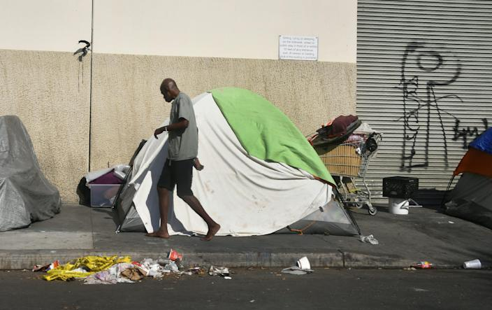 Tents house the homeless on a street in Los Angeles. (Photo: Frederic J. Brown/Getty Images)