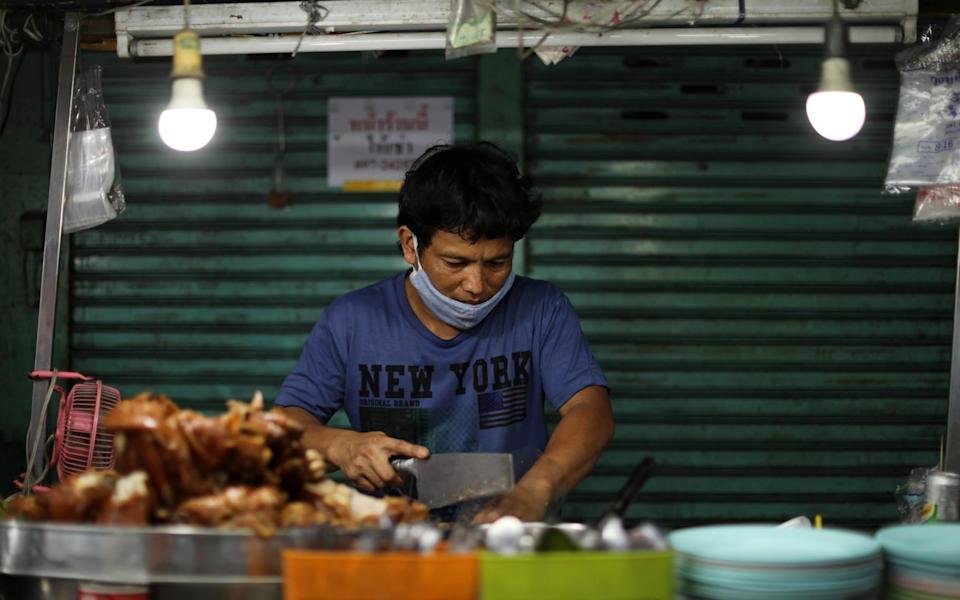 A vendor is seen at the stall, after the government eased some protective measures following the coronavirus disease (COVID-19) outbreak in Bangkok, Thailand - Jorge Silva/Reuters