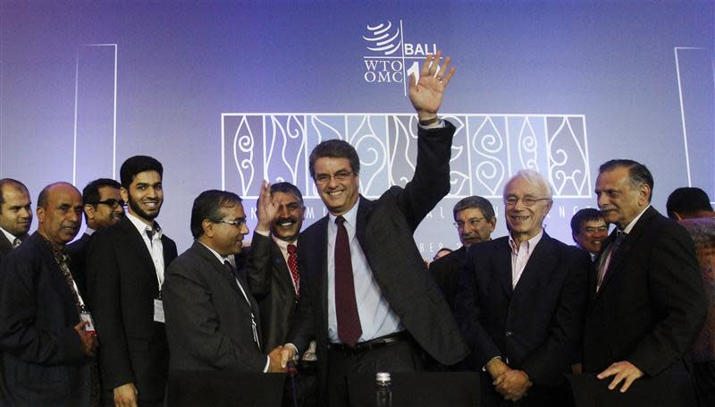 Director-General Azevedo gestures as he is congratulated by delegates after the closing ceremony of the ninth WTO Ministerial Conference in Nusa Dua