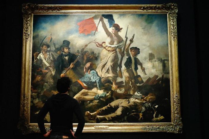 """Facebook apologised in March for temporarily removing an advert featuring French artist Eugene Delacroix's famous work """"Liberty Leading the People"""" because it depicts a bare-breasted woman (AFP Photo/PATRICK KOVARIK)"""