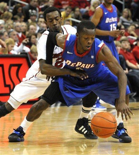 Louisville's Russ Smith, left, attempts to steal the ball from DePaul's Worrell Chahar during the second half of their NCAA college basketball game Saturday, Jan. 14, 2012 in Louisville, Ky. Louisville defeated DePaul 76-59. (AP Photo/Timothy D. Easley)