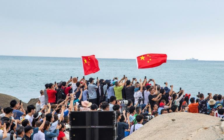 A band played music as onlookers snapped photos during the launch -- a milestone in Beijing's plans to establish a permanent human presence in space