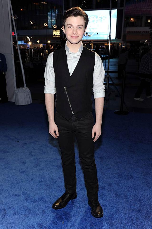 "Cory's adorable co-star Chris Colfer kept things casually cool in an asymmetrically-zippered vest and rolled-up sleeves. Frazer Harrison/<a href=""http://www.gettyimages.com/"" target=""new"">GettyImages.com</a> - January 5, 2011"
