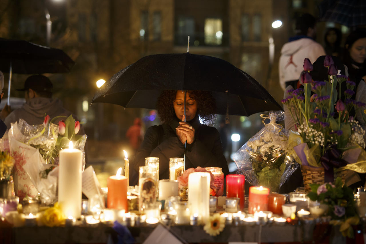 <p>Senait Teclom attends a vigil for the victims of the mass killing on April 24, 2018 in Toronto, Canada. (Photo: Cole Burston/Getty Images) </p>