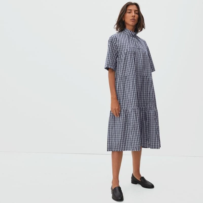 """<h2>Everlane The Tiered Mockneck Dress</h2><br><strong><em>The Transitional Trend Piece</em></strong><br><br><a href=""""https://www.refinery29.com/en-us/tiered-dresses"""" rel=""""sponsored"""" target=""""_blank"""" data-ylk=""""slk:Tiered dresses"""" class=""""link rapid-noclick-resp"""">Tiered dresses</a> have been all the rage throughout the warmer months of this year, and Everlane's latest take features the necessary prints and fabric to transition the style into the fall. As one reviewer put it, the dress works best when paired with a fall-friendly pair of mules or loafers.<br><br><strong>The Hype: </strong>4.6 out of 5 stars; 10 reviews on Everlane.com<br><br><strong>What They're Saying</strong>: """"Myyyy Ohhhh Myyyy: This dress is absolutely flattering. I knew I had to have it once I tried it on in-store and another customer saw it on me and shouted 'WOOOOW that looks beautiful on you.' It's super comfy and stylish. I actually had to size down since it runs larger. I plan to wear it this fall with my 1 of my Tory Burch flats. I cannot wait. This dress is a must-have yall.""""— Tujuana Monae, Everlane reviewer<br><br><em>Shop <strong><a href=""""https://www.everlane.com/products/womens-tiered-mockneck-dress-blue-plaid?collection=womens-dresses"""" rel=""""sponsored"""" target=""""_blank"""" data-ylk=""""slk:Everlane"""" class=""""link rapid-noclick-resp"""">Everlane</a></strong></em><br><br><br><strong>Everlane</strong> The Tiered Mockneck Dress, $, available at <a href=""""https://go.skimresources.com/?id=30283X879131&url=https%3A%2F%2Fwww.everlane.com%2Fproducts%2Fwomens-tiered-mockneck-dress-blue-plaid"""" rel=""""sponsored"""" target=""""_blank"""" data-ylk=""""slk:Everlane"""" class=""""link rapid-noclick-resp"""">Everlane</a>"""